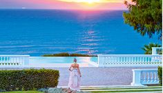 Enjoy your wedding ceremony with a sunset view to the Aegean Sea. Book the venue of your dreams for a spectacular wedding day at BookYourWeddingDay.com. #BookYourWeddingDay #WeddingVenue #WeddingCeremony #Greece