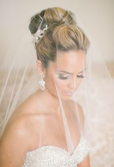 Top bun, lashes for miles, gorgeous sheer veil, sophisticated wedding hairstyles // Ashlee Mintz Photography
