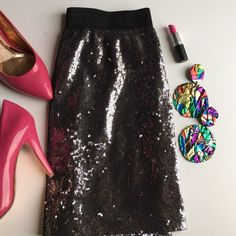 "Sequin mini skirt Elastic waist is 13 inches across. 16 inches long. By ""Aqua"" Skirts Mini"