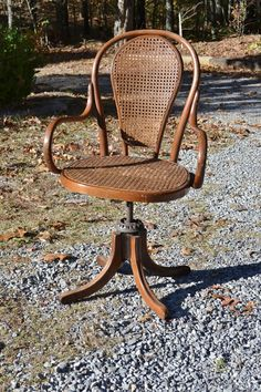 https://www.etsy.com/listing/473947654/vintage-bentwood-cane-swivel-desk-chair?ga_order=most_relevant