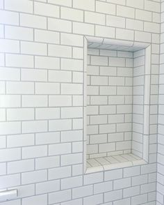 Loving how the platinum grout we chose turned out with the white subway tile for this little boys bathroom 💙 Tile Shower Niche, White Subway Tile Bathroom, Subway Tile Showers, White Tiles Grey Grout, Shower Walls, Grey Grout Bathroom, Bathroom Floor Tiles, Bathroom Renos, Bathroom Ideas