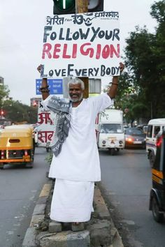 This man holding up a sign promoting religious tolerance in Mumbai. This world needs some more