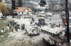 View of the market place at Travnik, Bosnia shortly after the arrival of British forces in Bosnia at the start of Operation GRAPPLE. Civilians cluster around two Warrior armoured fighting vehicles of 1 Cheshire Regiment. Veterans Office, Republika Srpska, Colorized Photos, Armored Fighting Vehicle, Serbian, Bosnia, Armored Vehicles, Warfare, Military Vehicles