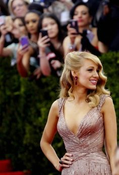 Blake Lively working the red carpet. Paparazzi.
