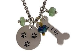Stamp your pet's name on the bone! Visit http://www.ninadesigns.com/jewelry_design_ideas/silver_bone_charm.html for stamping blanks & jewelry making supplies