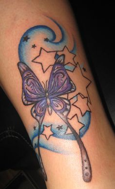 Butterfly tattoo with starts and blue 'swirlies', ankle area