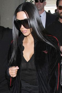 How to get Kim Kardashian's sleek, shiny and super straight hair. Plus more celebrity beauty tips and tricks to try here:
