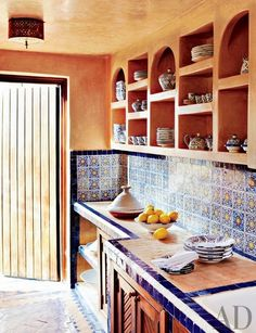 Morrocan kitchen. Blue and yellow. Dar Maktoub. 18 century riad. Essaouira, Morroco