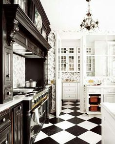 Floors - Over-sized black and white checkered pattern -- This is it. This is my dream kitchen. The floors, the wallpaper, the stove, the cabinets, everything! I'm in absolute love.