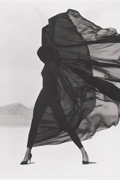 Christy Turlington photographed by Herb Ritts wearing Versace veiled dress in El Mirage in 1990