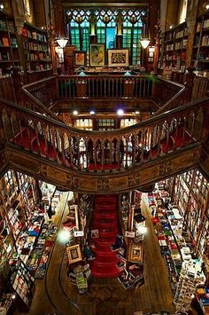 Lello  Irmao in Porto, Portugal usually makes the various lists of The Top 10 Most Beautiful Bookstores in the World. It opened in 1906 and features stunning Art Deco woodwork, a stained glass ceiling, and ornate shelving with a dramatic staircase up the center of the store.