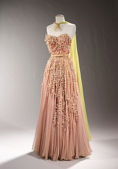 Evening dress Designer: Sophie Gimbel (American, Houston, Texas 1898–1981 New York) Date: 1955 Culture: American Medium: silk, rhinestones Dimensions: Length at CB (a): 60 in. (152.4 cm) (c): 63 in. (160 cm) Credit Line: Brooklyn Museum Costume Collection at The Metropolitan Museum of Art, Gift of the Brooklyn Museum, 2009; Gift of Sophie Gimbel, 1955