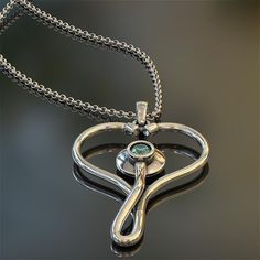 """Beautiful pendant handmade by artisan jewelers from precious metals that will ShineOn for a lifetime. Made from your choice of the highest quality Oxidized .925 Silver or 24K Gold Plated .925 Silver. This truly unique and limited design will be hand checked by the jeweler and ShineOn before being hand packaged and shipped to your door. Necklace comes with 16"""" - 22"""" adjustable chain."""