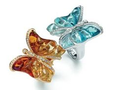 Carved blue topaz, citrine, and 18k gold butterfly rings.... Butterflies are my favorite...