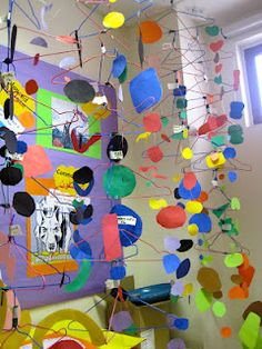 artists studied the work of Alexander Calder and made their own kinetic sculptures with fishing line, wire hangers and construction paper.