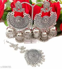 Jewellery Set Arya Stylish Women's Earrings and Maang Tikka  Base Metal: Alloy Plating: Silver Plated Stone Type: Artificial Stones Sizing: Non-Adjustable Type: 1 Pair of Jhumkas and Maang Tikka  Multipack: 1 Country of Origin: India Sizes Available: Free Size   Catalog Rating: ★4 (553)  Catalog Name: Arya Stylish Women's Earrings and Maang Tikka CatalogID_751135 C77-SC1093 Code: 022-5096130-774