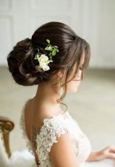 Loose Low Bun Flower Hairpiece Wedding Hairstyle