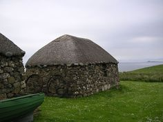 Black House, Isle of Skye - Scotland. The Skye Black Houses were thatched stone cottages many of which the people had to abandon in the Highlands and Islands in the 1800s. With its earthen floor and peat fire stack in the middle of it, the smoke could only escape through a hole in the roof. With no windows to shed any more light inside, the peat smoke not only blackened the walls, but made for a murky, dark interior, so giving the blackhouses their name.