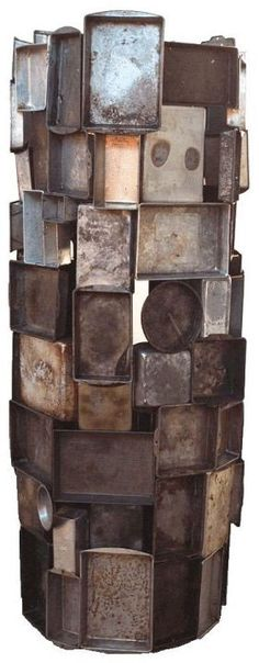 "Below: Sally's ""Tower of Pans"" sculpture from 1996; 81"" tall  x 34"" in diameter."