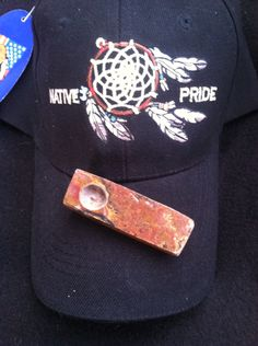 Hand carved Colorado Purple onyx carved by Running Wolf of PEEDEE Indian Tribe with Native Pride hat
