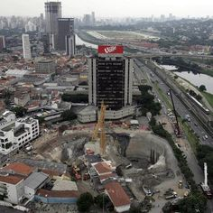 In January 2007, a huge crater opened at the construction site of the Pinheiros subway station in Sao Paulo, Brazil. Officials said a passenger minivan had fallen to the bottom of a 40-metre (130-foot)-deep pit dug to facilitate delivery of supplies for workers, and the lip of the hole gave way to a landslide, taking with it vehicles on a roadway around the edge and dumping tons of earth, asphalt and concrete on them.