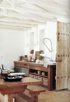 the old wooden doors, the white ceiling beams, the wooden table .. all simply gorgeous