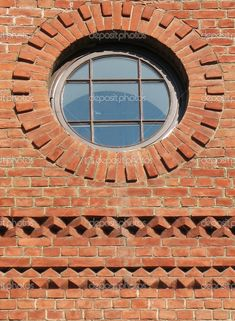 Brick wall with a round window and nice brick details - photo by ZanozaRu, via depositphotos  ...location not given...
