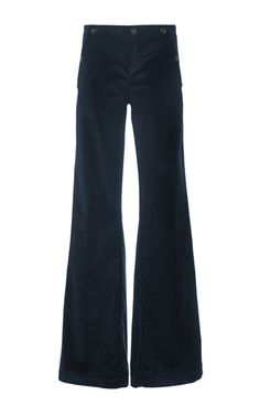 Chic and flattering, this heritage denim brand rose to fame in the 1970s for its graceful, patch-pocketed flares. Today they deliver jean classics, reinterpreted for a modern audience and crafted from the softest Italian denim. These **Seafarer** high waisted velvet trousers are made with a plush navy corduroy fabric and feature wide pant legs and an sailor-style embellished button on the closure.