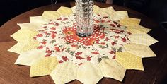 This Will Be Charming In Your Favorite Colors, Too! Hexagons and Dresden Plate blades combine to make this unique and sunny table topper. Inspired by sunflowers, it's a wonderful little quilt to display on a table during warm weather months. Or, go ahead and leave it out all year around. You're sure to enjoy this …