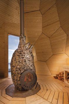 Inside, a heart-shaped wood-fired burner provides heat