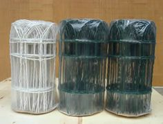 Two rolls of green and one roll of white decorative wire border fence packed in plastic film