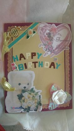 Handmade card using cardboard, quill flowers..