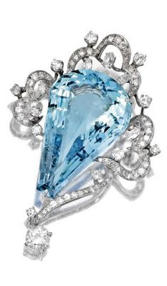 AQUAMARINE AND DIAMOND JEWELRY, CIRCA 1930-1950 The brooch set with a modified pear-shaped aquamarine weighing approximately 40.00 carats within a frame of scrolls set with round and marquise diamonds