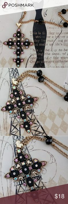 """Betsey Johnson Cross Necklace Beautiful black and gold cross accented with crystals. Cross is 2 3/4""""L x 2 1/4""""W. Chain 26"""" long with 21/2"""" extender. Cross is centered on chain, it doesn't slide. The chain also has crystals. Excellent preowned condition. Betsey Johnson Jewelry Necklaces"""