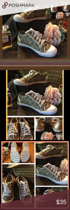 Coach Tennis Shoes, Sneakers Gold Leather Trim 6B Preowned, Coach signature, in brown and tan with gold leather trim, sneakers. They are a size 6B in good condition.  The white rubber does show some wear. The gold leather heels do have scuff marks.  They are great shoes with a lot of wear left. Box not included. Coach Shoes Sneakers