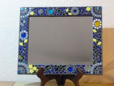 A personal favorite from my Etsy shop https://www.etsy.com/listing/237310740/stained-glass-mosaic-mirror-whimsy
