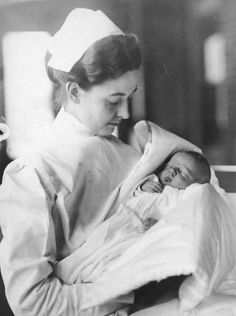 *LUCIEN P. SMITH JR.~ Newborn baby boy in the arms of a nurse, November 1912. Smith's mother, Eloise Hughes Smith (1893 - 1940), was pregnant while a passenger returning from her honeymoon on board the White Star liner Titanic when the ship sank on 15th April 1912. Smith's husband, Lucien P. Smith, was also on board, but did not survive. Eloise later married a fellow Titanic survivor, Robert P. Daniel.