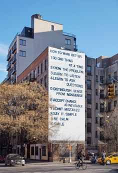 """An iconic mural towers over the intersection of New York's Houston and Mott Streets, a 50-foot-tall piece produced in tandem with the Guggenheim's exhibition """"Peter Fischli and David Weiss: How to …"""