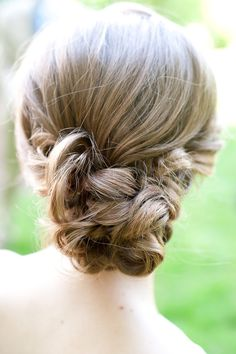 wedding hairstyle--can be adorable, but tricky to avoid it looking like one of those topsy turvy, banana curly things