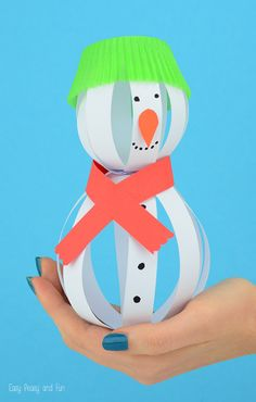 Paper Snowman Craft - easy little snowman made of paper strips. It would be fun craft to do with kids for winter!