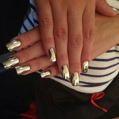Mirrored nails - just take aluminium foil and apply on your wet nail polish. :)