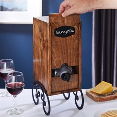 The Cunningham wooden box wine holder is a stylish wine dispenser specially designed for boxed reds & whites. To dispense your favorite wine, just open the cardboard package and remove the bag. Then slide open the front panel to insert bags up to 3 liters. A perfectly cut notch holds the spout. Perfect to keep generous amounts flowing at weddings and parties, or enjoying a glass throughout the week. An ice pack is included to keep chardonnay and other white wine cool while serving, and a ...