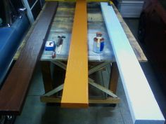 """After we've removed all our sanding dust and created a work surface. It's time to paint. On the right is our newly distressed beam. in the middle is our first and only base coat of flat """"woodland"""" . I used Valspar products - paint code 2006-5A. On the left is our completed beam, coated with Valspar """"Java"""" satin finish (shelf item in my store) and wiped with a paper towel while wet to create a multi-tone/textured look."""