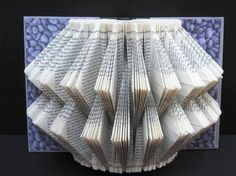 """Saw a wonderful hanging exhibit of folded books today. Like this, but """"in the round. Folded Book Art, Paper Book, Book Folding, Paper Folding, Paper Art, Book Crafts, Paper Crafts, Book Lamp, Cool Artwork"""