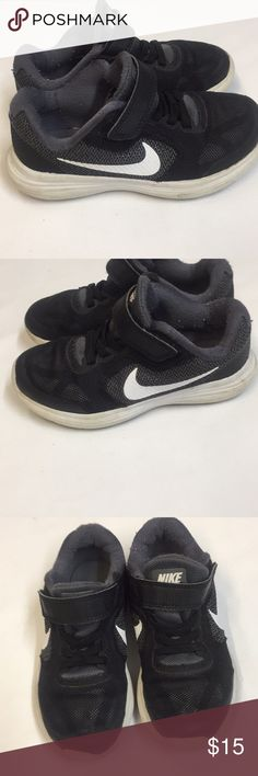 Boys 11c Nike Revolution 3 Sneakers. Black and White with little signs of wear on shoes. Bottoms in good condition with much grip. Velcro straps and elastic laces. Nike Shoes Sneakers