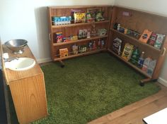 Promoting role play with real life materials. Pantry stocked with empty recycled boxes, bottles and jars. Bottles And Jars, Child Care, Role Play, Reggio, Empty, Pantry, Real Life, Recycling, Boxes