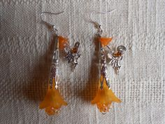 Amber sunset fairy filigree hand made earrings by KANDYLEES, $28.00     :0) who can't take a little magic in their lives ?