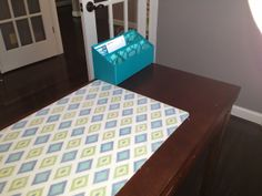 Spice up a boring desk with a fabric backed desk pad- easy to make & easy to change!