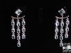 SellPin.com: Pins for Sale by Owner: Aquamarine chandelier earrings. Approximately 5.5CTW of fine quality aqua ovals set in 925 sterling silver overlaid with rhodium. Asking $300 USD. These are custom made. $300