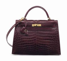 SAC KELLY SELLIER 32 CROCODILE NILOTICUS LISSE BORDEAUX, GARNITURE EN MÉTAL DORÉ
